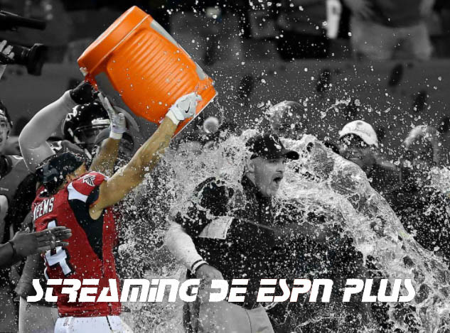 Athlete getting water poured on him.